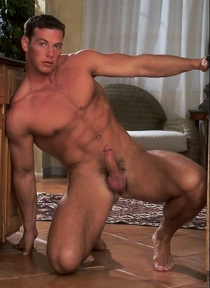 Hung muscle man Istvan Turani shows his big uncut cock